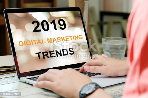 istock Man hand typing laptop computer with 2019 digital marketing trends on screen background, digital marketing, business and technology concept 1088337826