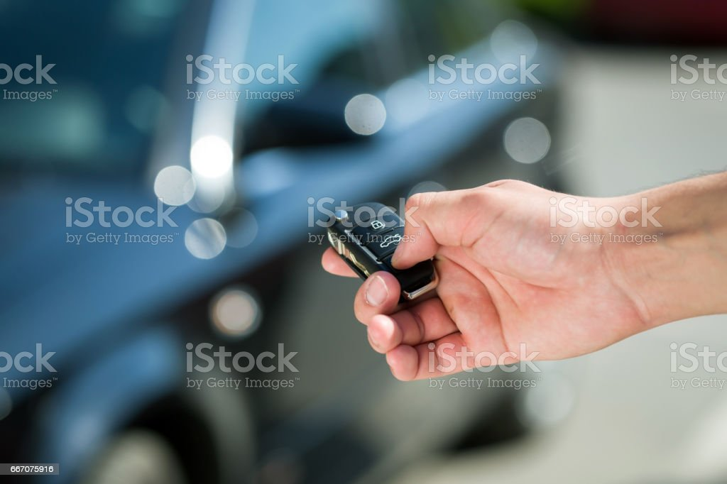 man hand unlocking car stock photo