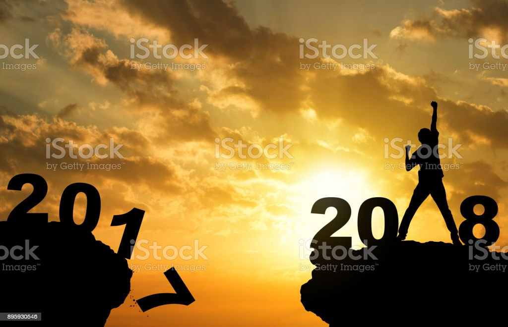 Man hand up on peak mountian sunset background  with text 2018 happy new year out door travel business concept stock photo