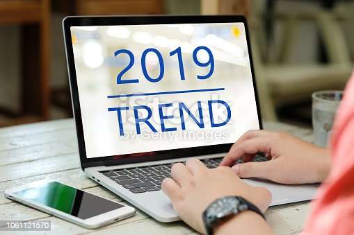 istock Man hand using laptop computer with 2019 trends on screen background, digital marketing, business and technology concept 1061121570