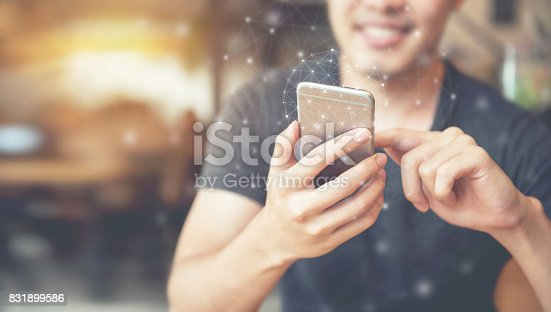 istock Man hand using mobile phone, Worldwide connection technology interface. 831899586