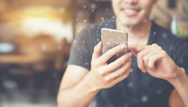 Man hand using mobile phone, Worldwide connection technology interface. stock photo