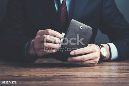 man hand wallet and money on table