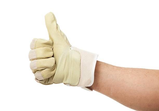 arbeitshandschuh show auf weißem hintergrund - arbeitshandschuhe stock-fotos und bilder