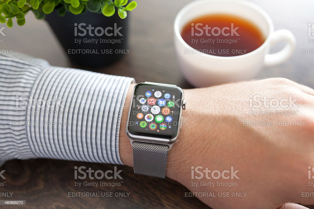 Man hand with Apple Watch and app Icon on screen stock photo