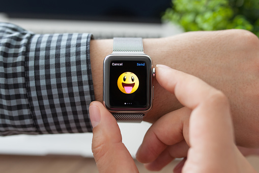 Man hand with Apple Watch and smile on a screen