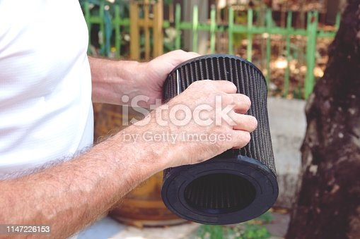 istock Man hand with Car air filter checking car engine 1147226153