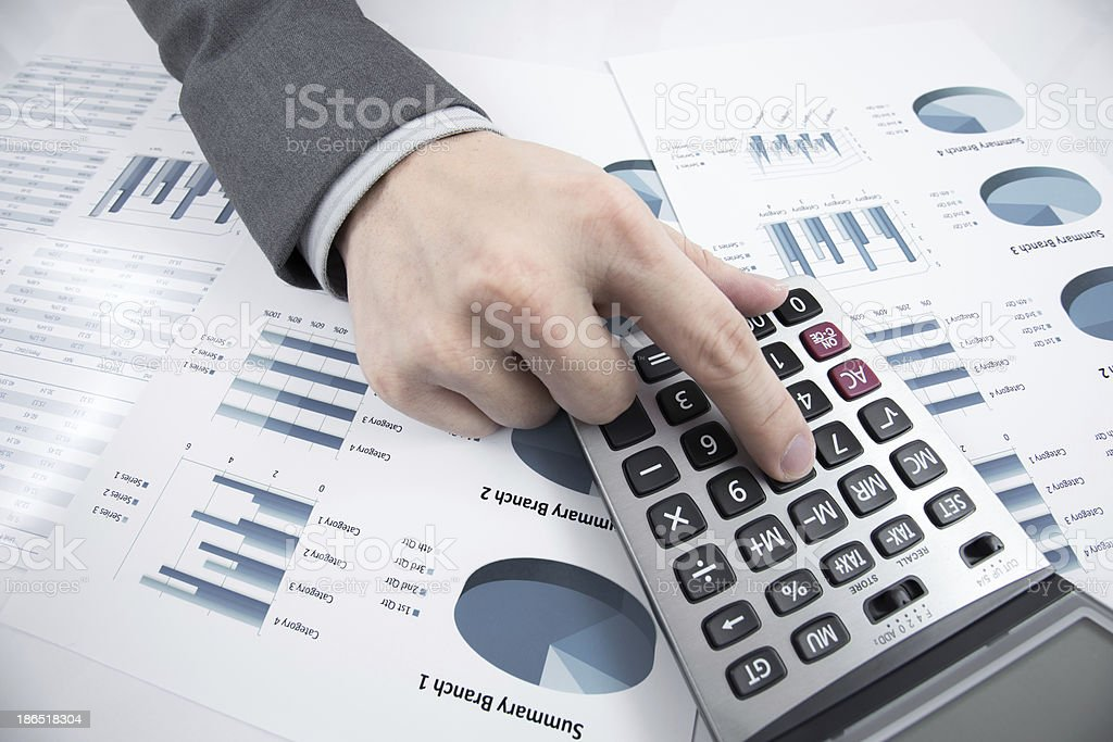 Man hand with pen and business report on table royalty-free stock photo