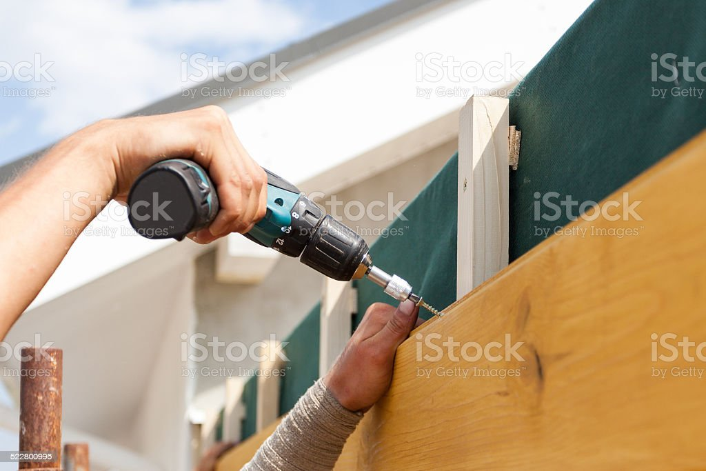 Man hand with screwdriver stock photo