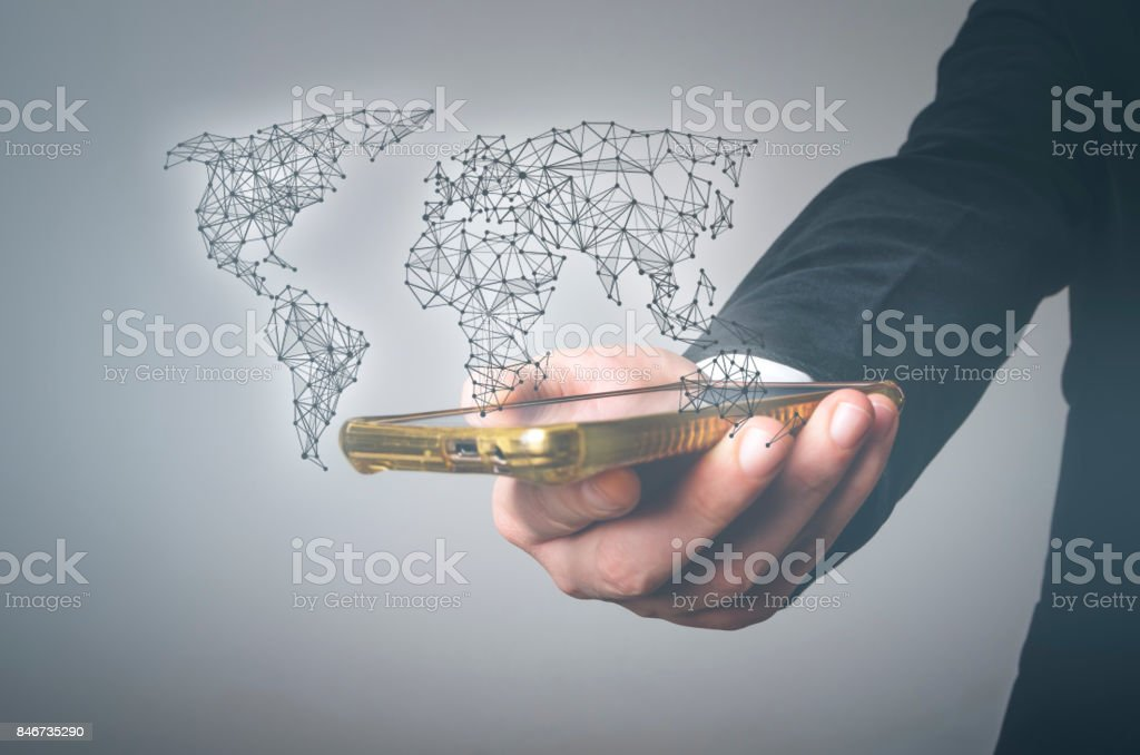 Man hand with smart phone and virtual world map stock photo