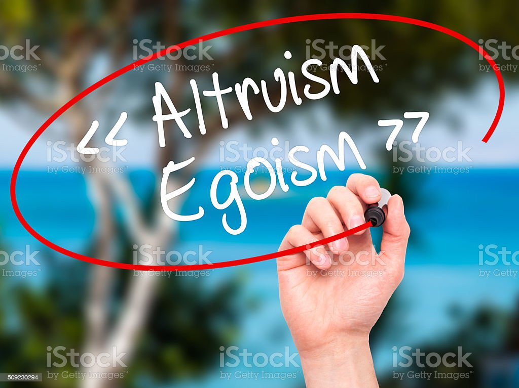 Man Hand writing Altruism - Egoism with black marker stock photo