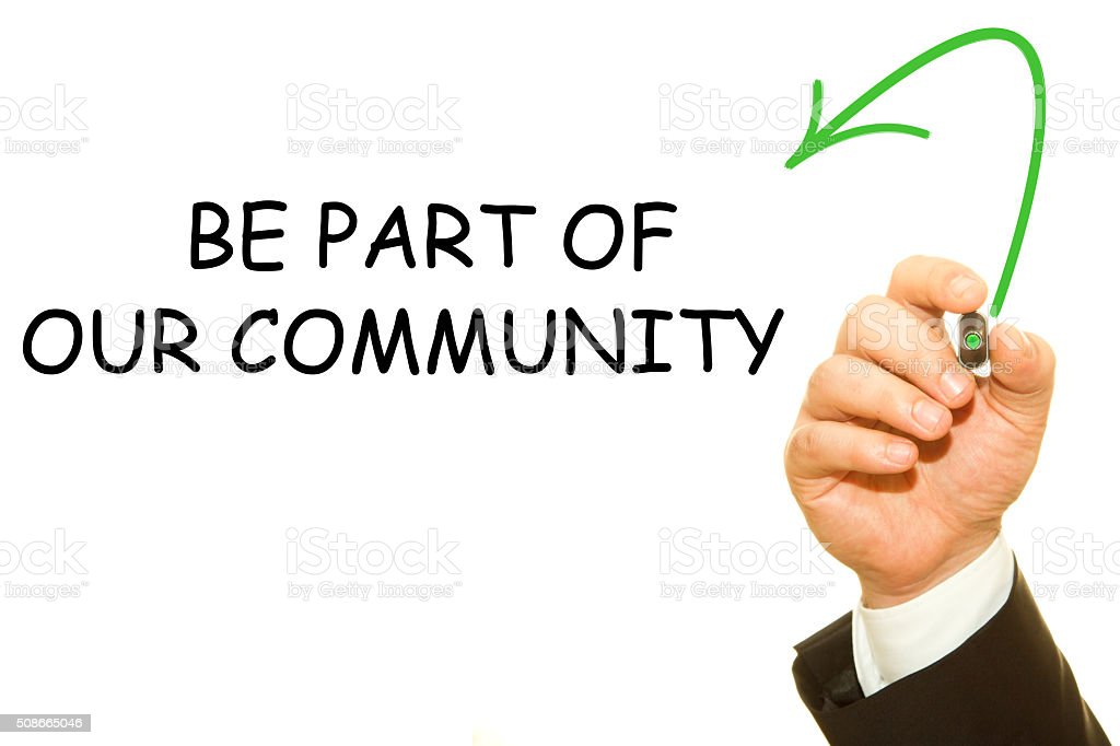 Man Hand writing BE PART OF OUR COMMUNITY stock photo