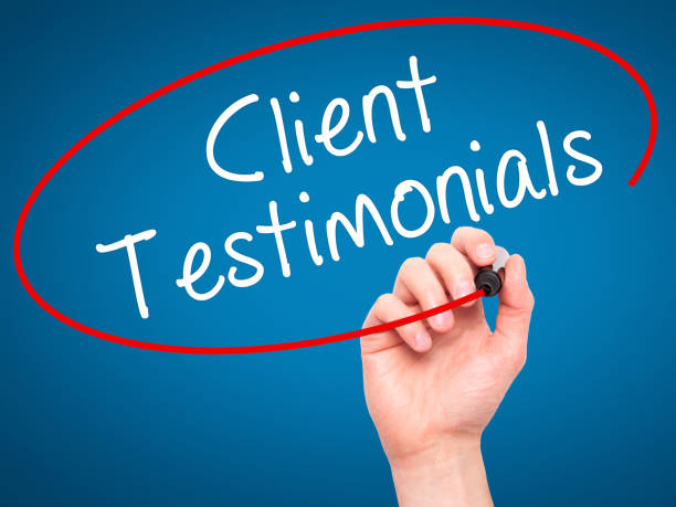 man hand writing client testimonials with black marker on visual screen - testimonial stock photos and pictures