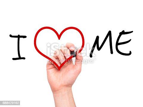 istock Man hand writing I Love Me on visual screen 688429162
