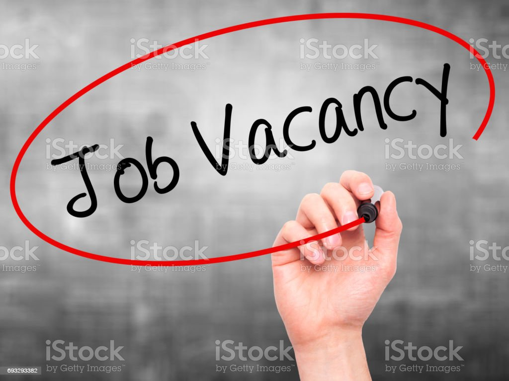 Man Hand writing Job Vacancy with black marker on visual screen stock photo