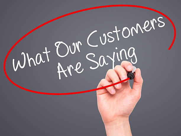man hand writing what our customers are saying with marker - testimonial stock photos and pictures