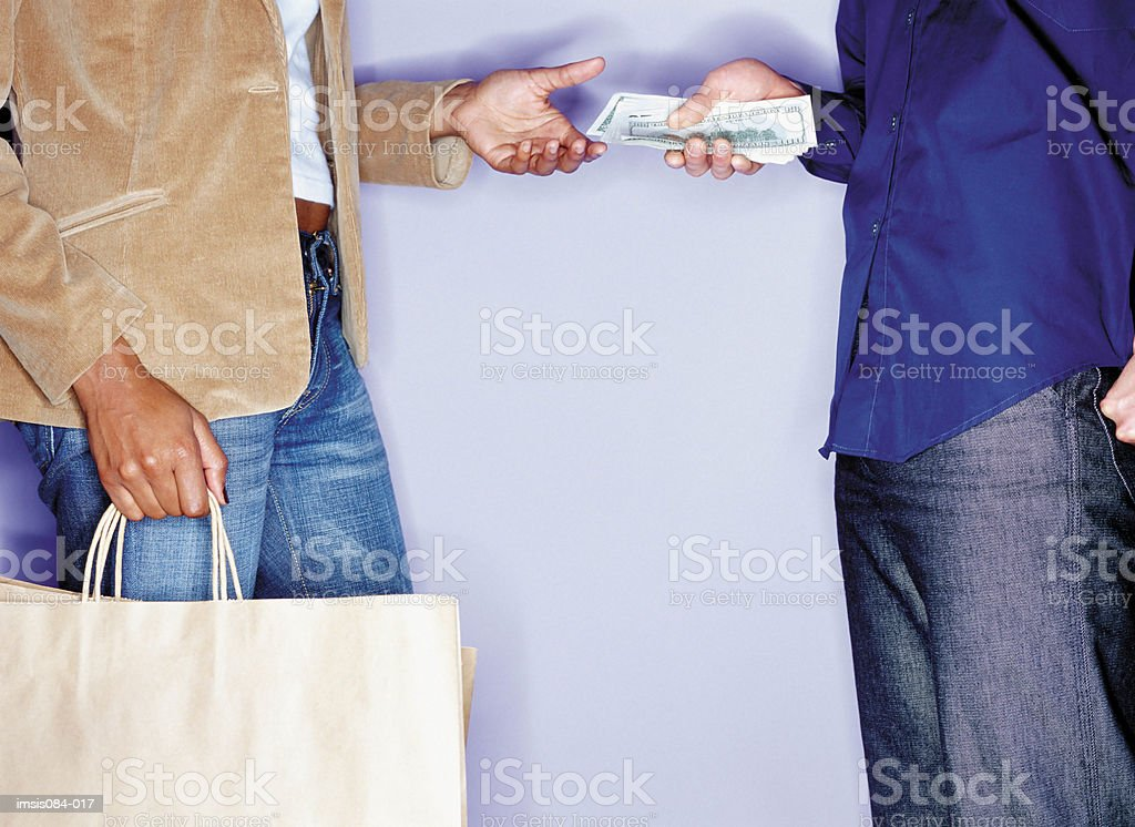 Man handing cash to a woman royalty-free stock photo