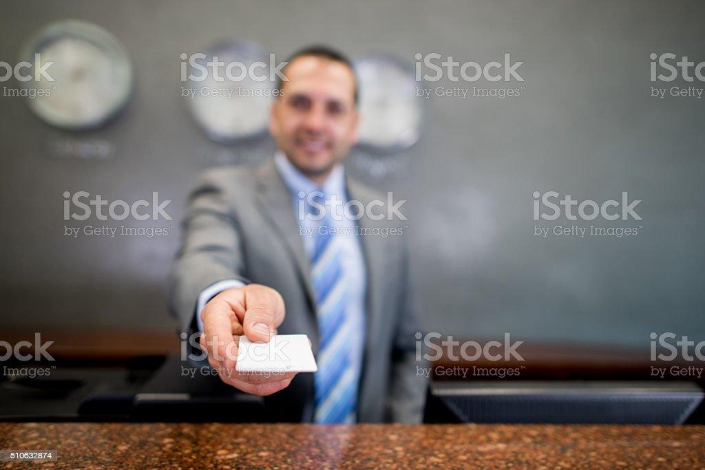 Man handling card key at a hotel stock photo