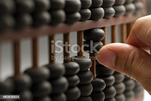 Old wooden abacus with a calculated