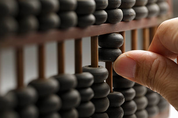 man hands are operating abacus - abakus bildbanksfoton och bilder