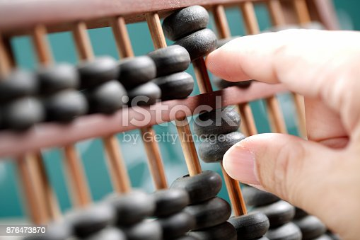 istock Man hands are operating abacus 876473870