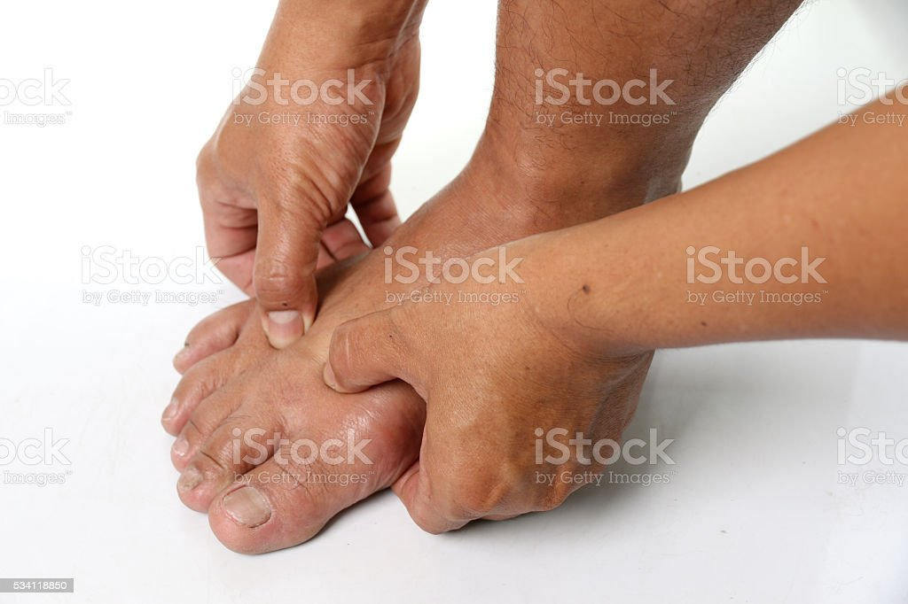 Man hands are squeezing the feet. stock photo