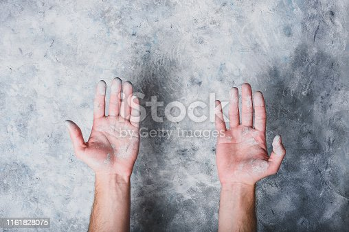 istock Man hands covered with paint 1161828075