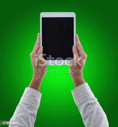 899410700 istock photo Man hands hold digital tablet isolated on green background 476383663