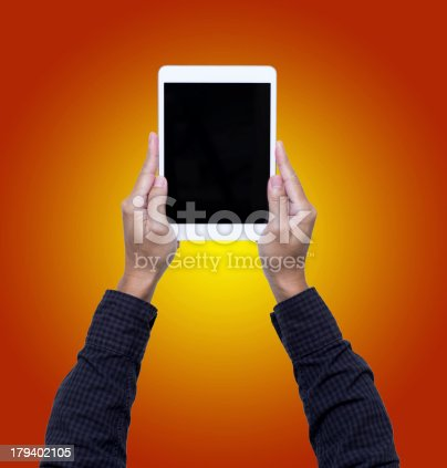 899410700 istock photo Man hands hold digital tablet isolated on orange background 179402105