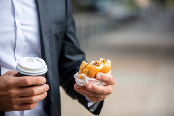 Man hands holding burger and coffee stock photo