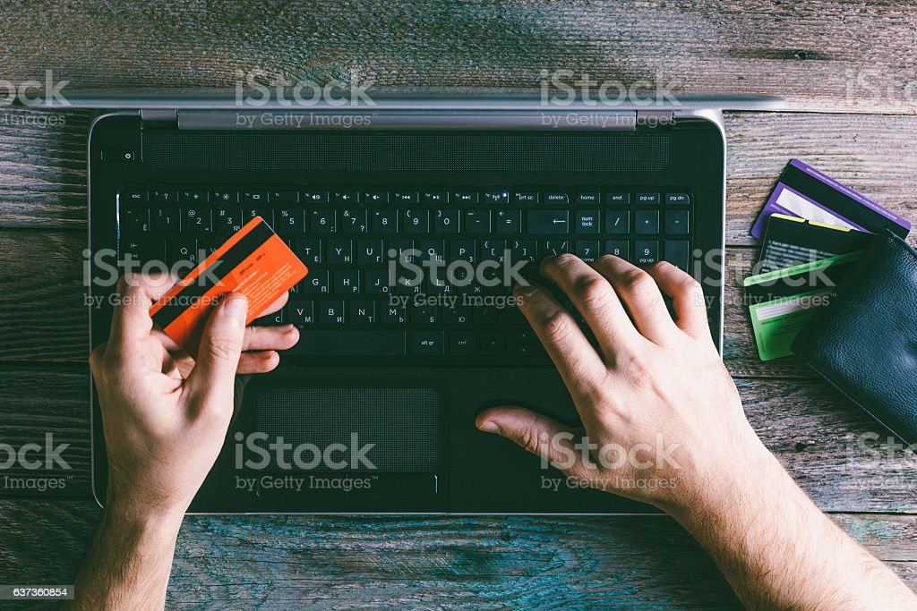 Man Hands holding credit card and using laptop stock photo