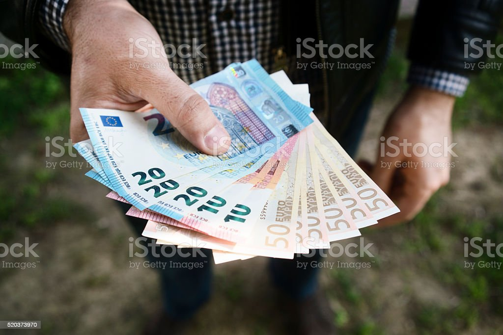 Man hands holding European bank notes stock photo
