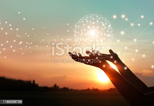 istock Man hands holding global network and data customer connection on nature background. 1165058709