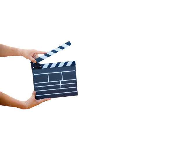 Man hands holding movie clapper isolated on white background. Shown slate board. use the colors white and black. stock photo