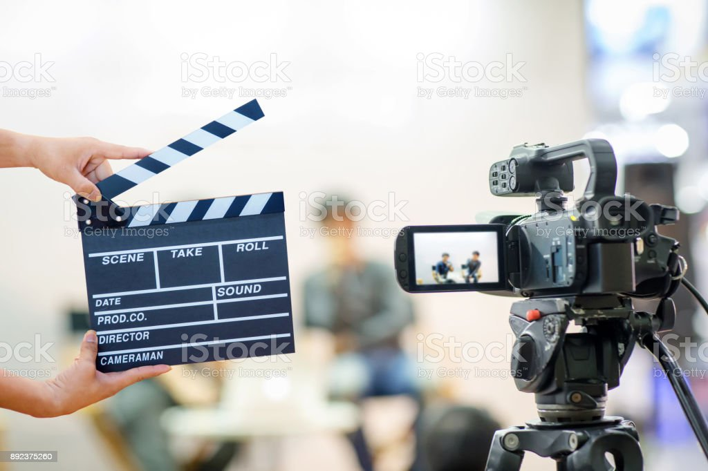 Man hands holding movie clapper. stock photo