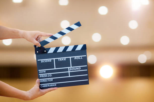 Man hands holding movie clapper.Film director concept.camera show viewfinder image catch motion in interview or broadcast wedding ceremony stock photo