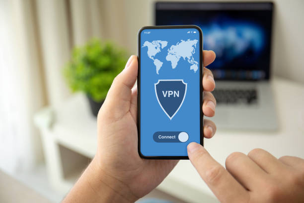 man hands holding phone with app vpn on the screen man hands holding phone with app vpn on the screen in the house in room vpn stock pictures, royalty-free photos & images