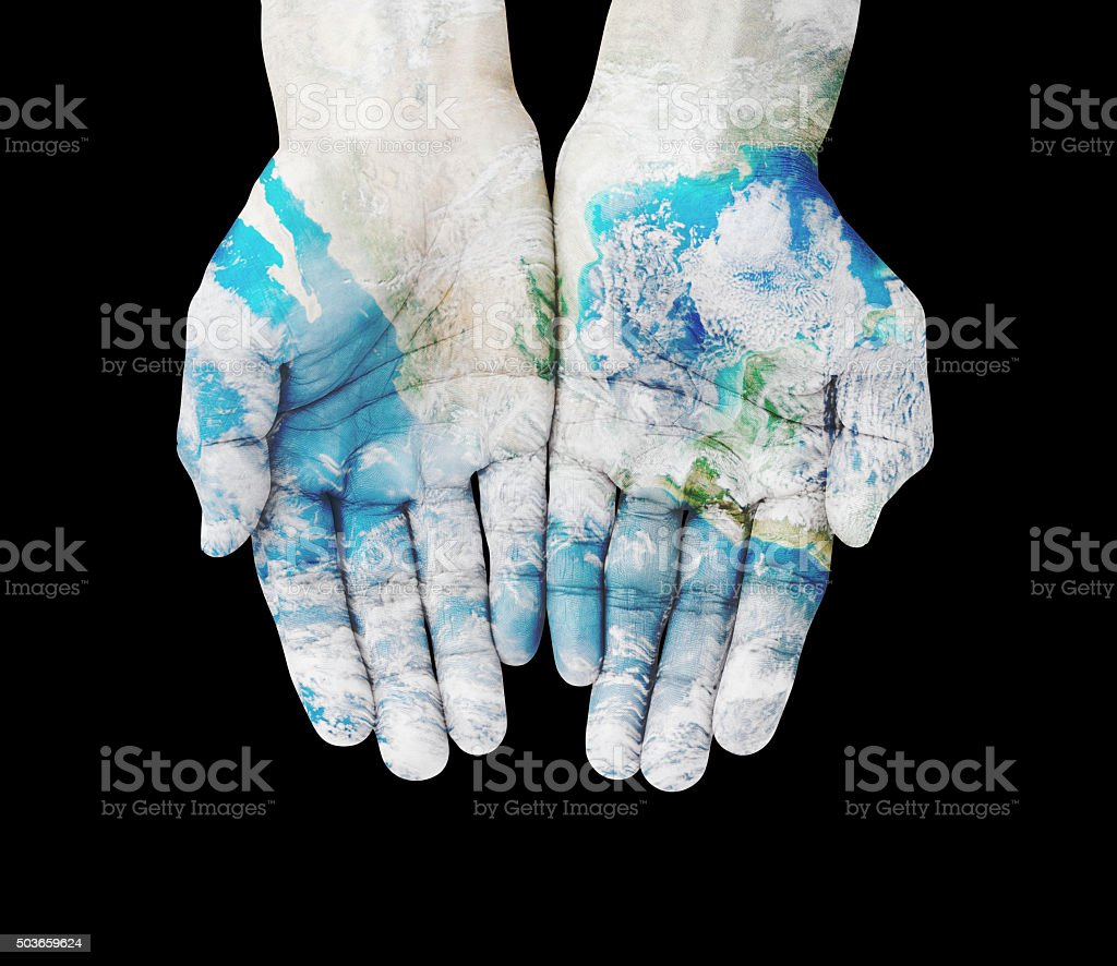 Man hands on earth , with clipping path stock photo