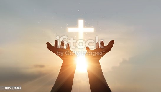 Man hands palm up praying and worship of cross, eucharist therapy bless god helping, hope and faith, christian religion concept on sunset background.