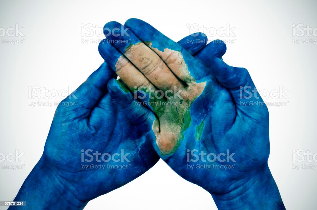 man hands patterned with a map of Africa (furnished by NASA) stock photo