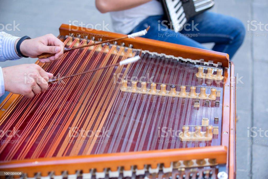 Man hands playing on harp, the Ukrainian national musical instrument, Ukraine стоковое фото