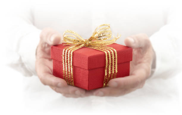 man hands show gift box - gradients golden ribbons imagens e fotografias de stock