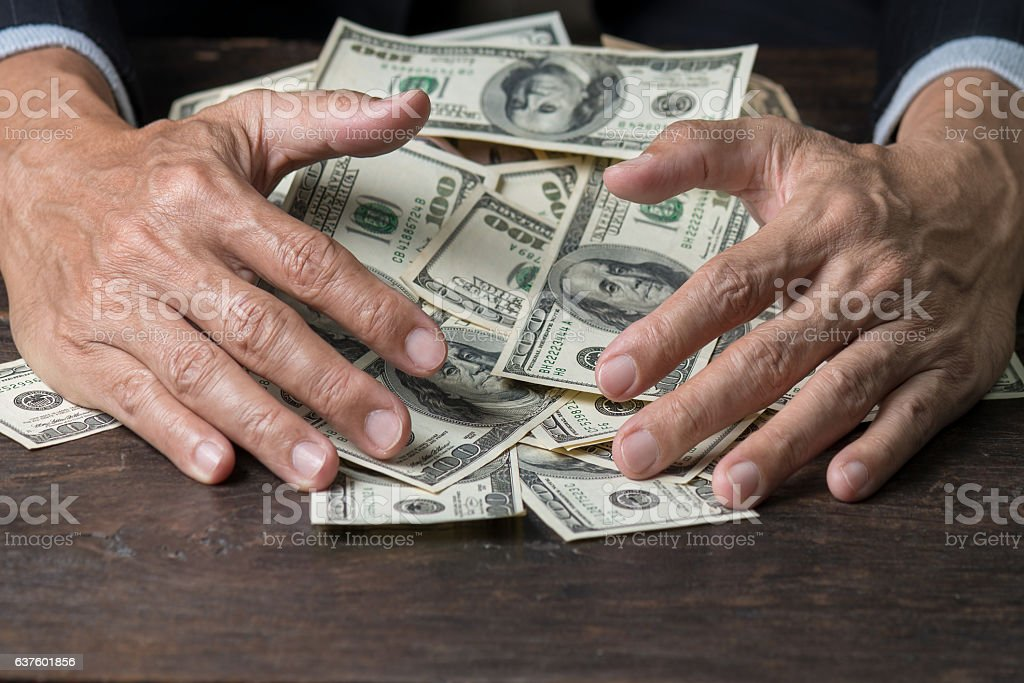 Man hands sweeping money,business concept. stock photo