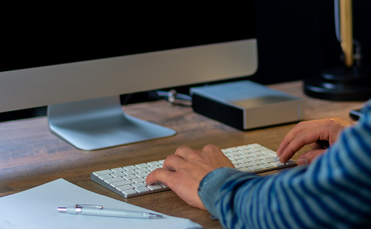 509867718 istock photo Man hands typing on computer keyboard 1178913888