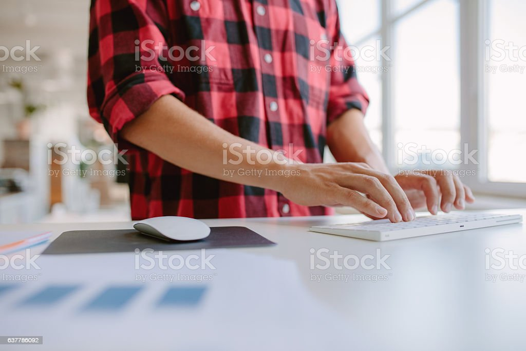 Man hands typing on computer keyboard stock photo