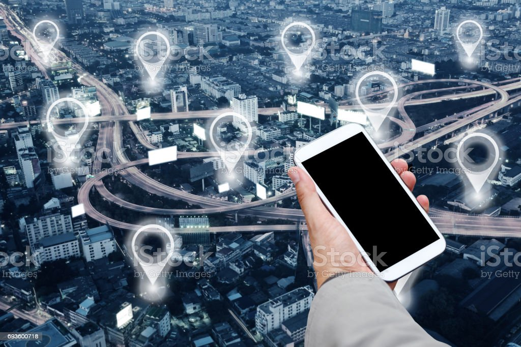 Man hands using mobile smartphone and Map pin in cityscape and network connection. Connection concept. stock photo