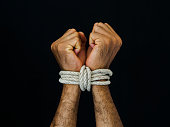 Man hands were tied with a rope. Violence, Terrified, Human Rights Day concept.