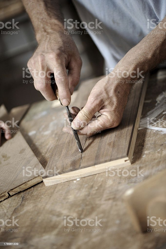 Man hands with carpenter's plane on wooden background royalty-free stock photo