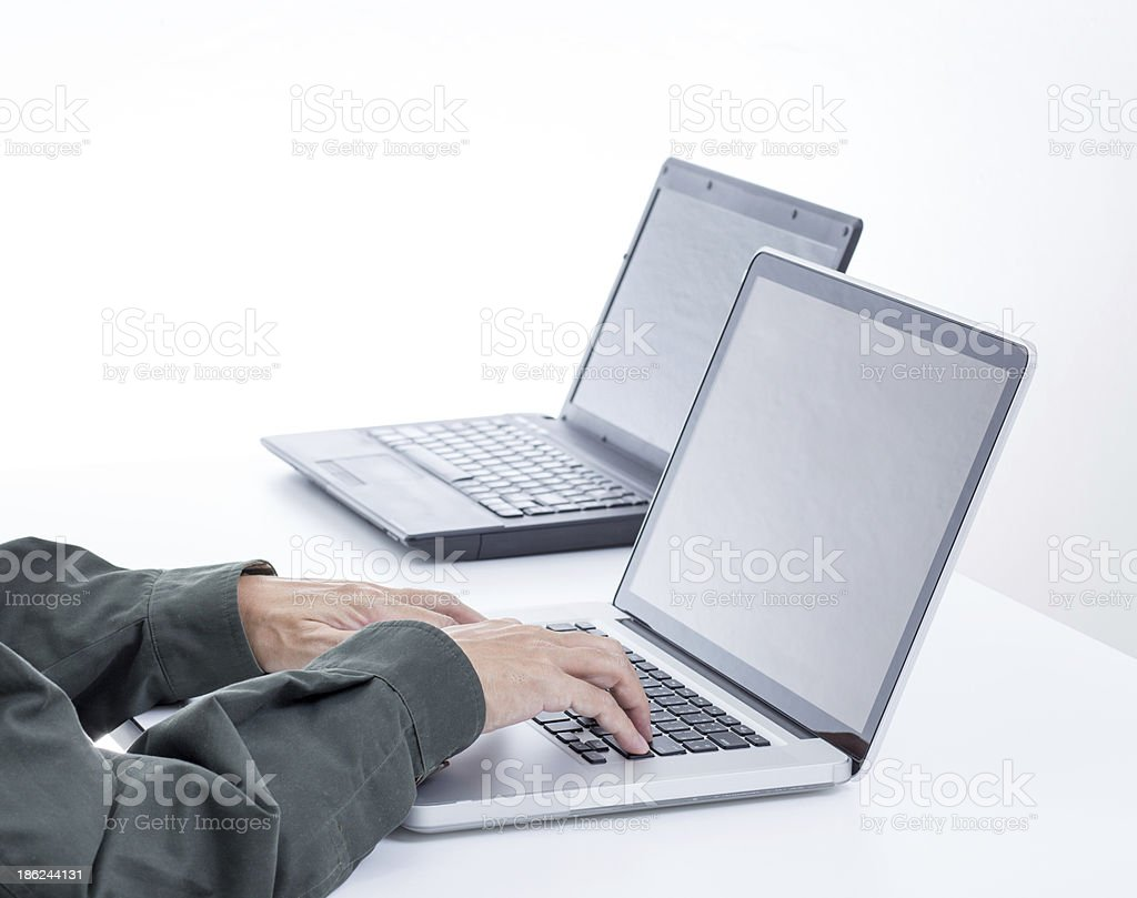 Man hands with laptop on white table royalty-free stock photo