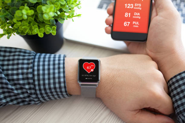 Man hands with watch and phone with app health Man hands with watch and phone with app health on the screen fitness tracker stock pictures, royalty-free photos & images
